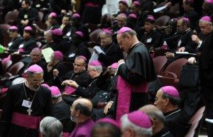 Catholic bishops take place for a session of a synod on the theme of