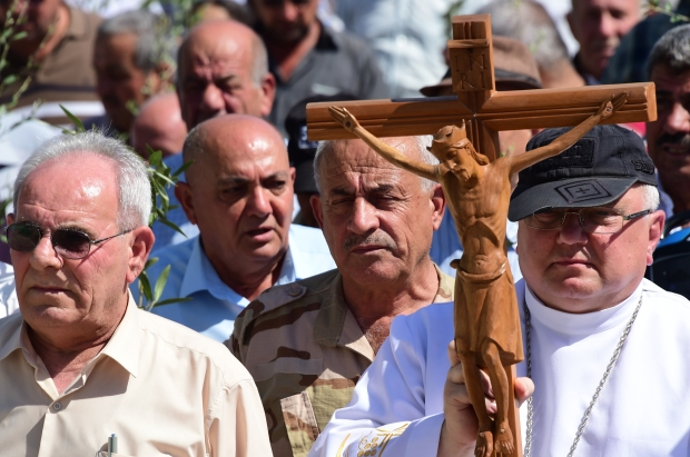 IDPs_ renovation_ houses_ Nineveh Plains_ procession_ crucifix_ cross_.JPG