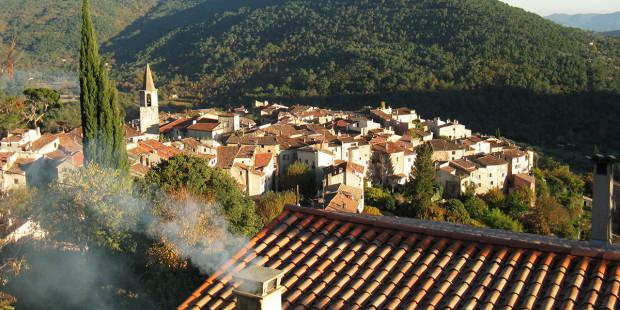 web3-bargemon-france-village-with-smokestack-and-church-steeple-shutterstock_757089706.jpg