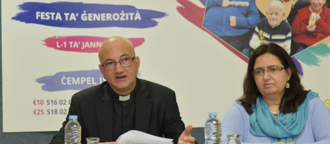 Fr_Martin_Micallef_assisted_by_Nadine_Camilleri_Cassano_at_Press_Conference_launching_Festa_ta_Generozita_2019.154461292738.jpg